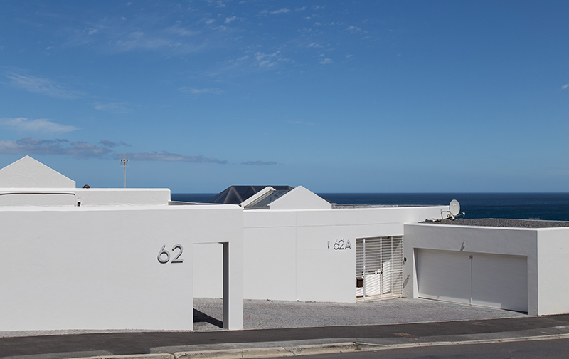 62 Camps Bay Drive's street view is understated and slick. Oh what wonders lie beyond these walls…