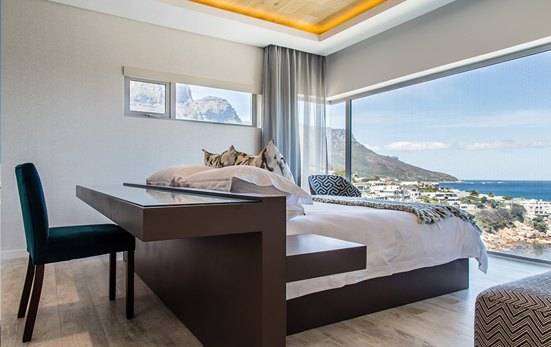 Clever design makes the functional fabulous in the main bedroom on the upper level. Working or relaxing, views are uninterrupted.