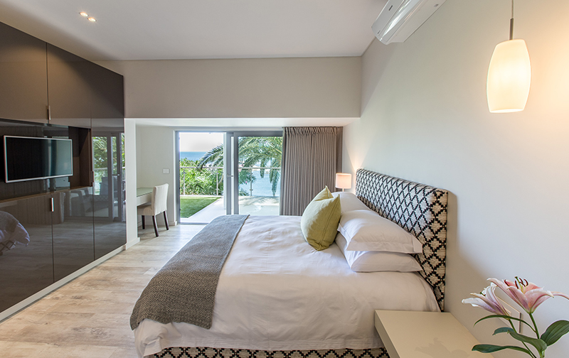 Bedroom 4 offers an en suite bathroom & access to the ground floor patio. Let the sea breeze in to create a true Zen experience.