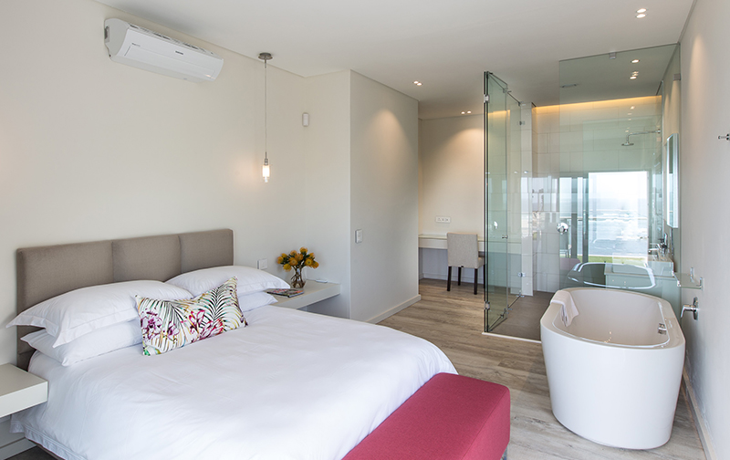 Bedroom 2 on the ground floor offers you everything you need with its queen size bed, bath,  shower & Atlantic Ocean views.