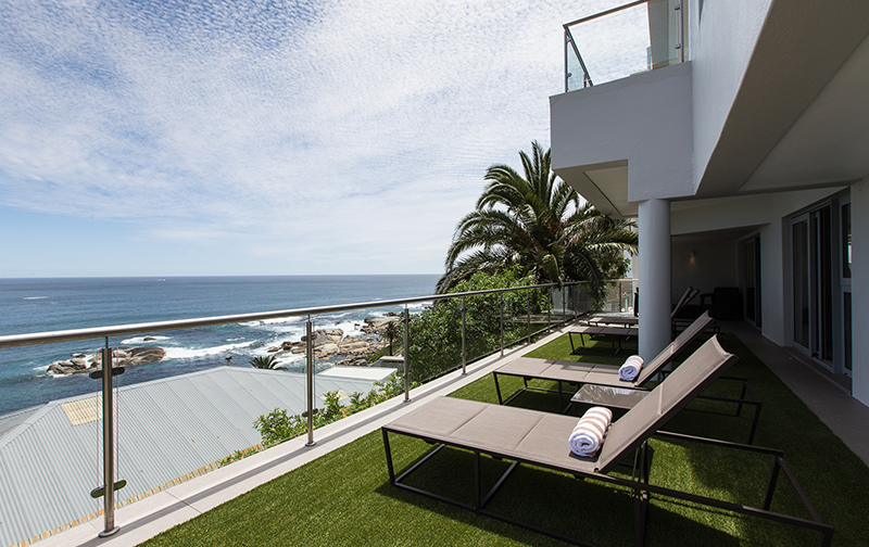 Pull up a recliner on the lower level patio and soak up the sun, sea and fresh air.